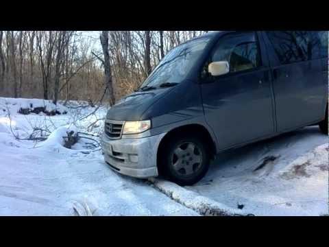 Mazda Bongo Friendee on the winter road.