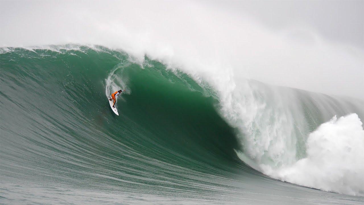 Big Wave Surfer Lucas Chumbo Snags A Giant Wave At Mavericks