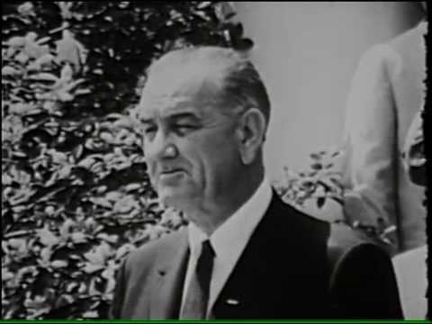 Download Youtube: President Lyndon B. Johnson Signs the Housing and Urban Development Act, 8/10/65.