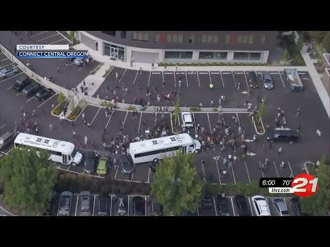 Bend protesters block 2 unmarked ICE buses; police chief to issue statement