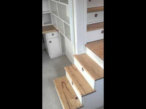 Loft bed with stairs, drawers, closet and desk