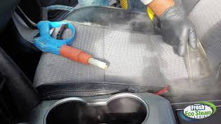 Deep cleaning seats with steam to remove the hidden stains.