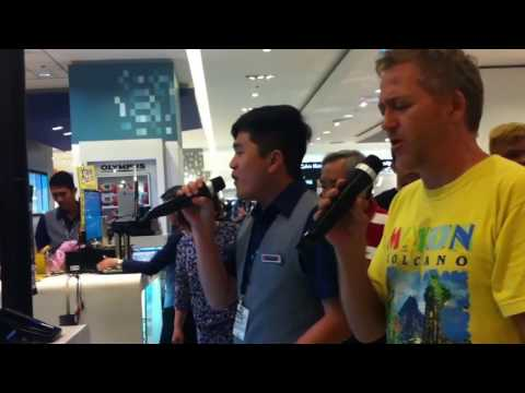 filipino sales man blows away crowd singing duet with american man singing