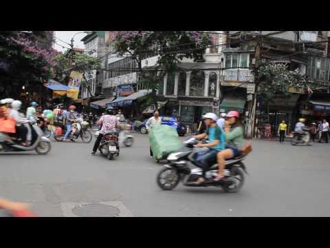 Crazy traffic flow in Hanoi , Vietnam