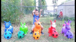 Ivan Play with Soccer Balls and Bouncy Animal Hoppers