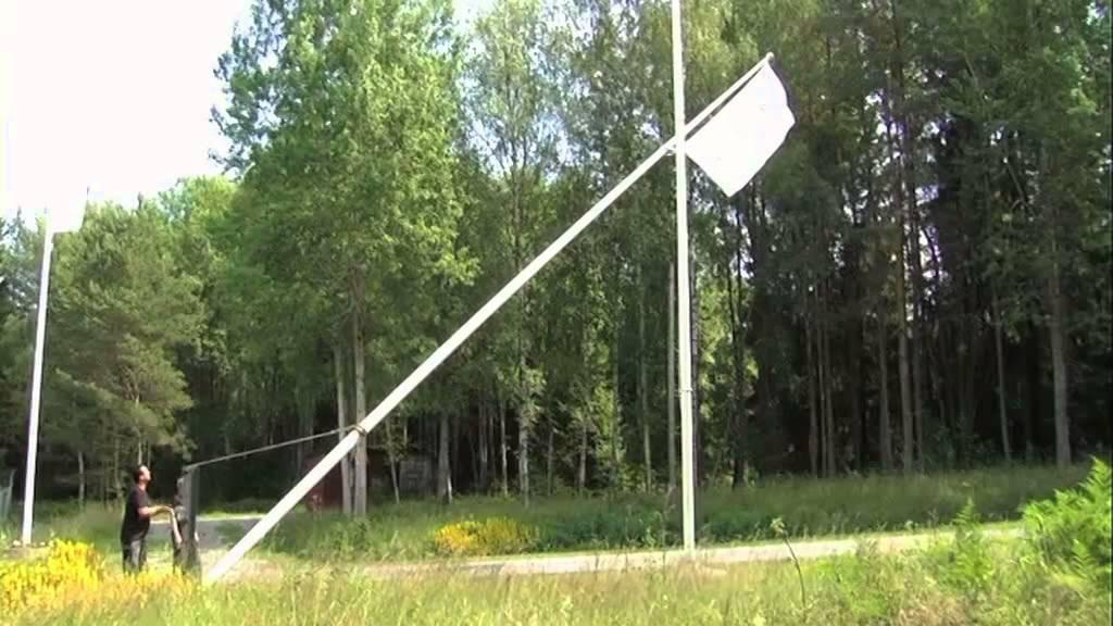 fälla flaggstång trä