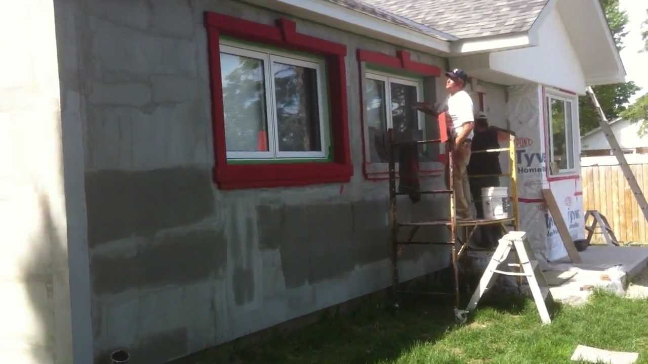 Red stucco being applied to the exterior of my home over bricks part 1 youtube How to plaster a house exterior