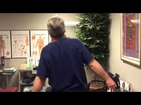 Your Houston Chiropractor Dr Gregory Johnson Adjust Himself With Adjusting Instrument