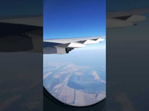 Flaying over Abu Dhabi coastline, islands and city in an Airbus A380
