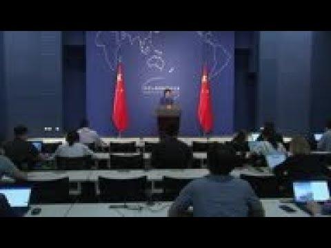 China threatens retaliation for Trump tariffs