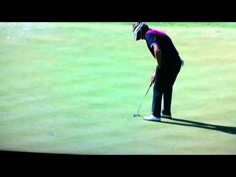 Poulter putts one handed