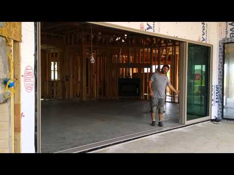 Western moving glass wall system