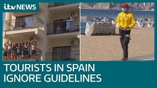 Tourists in Spain ignore emergency measures despite rise in coronavirus cases | ITV News