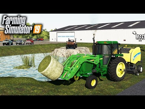 FS19- BALING & RAKING THE FRONT LAWN OF MY TRUCK DEALERSHIP | RCC thumbnail