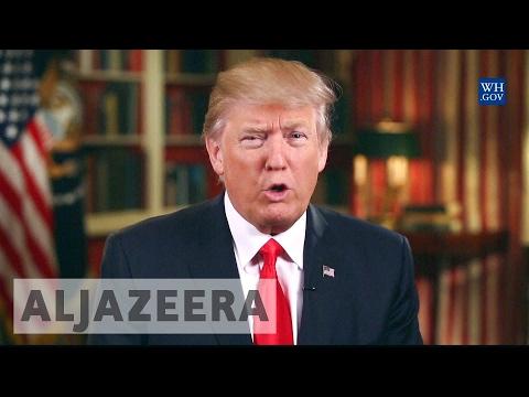 US Justice Department appeals freeze of Trump's travel ban