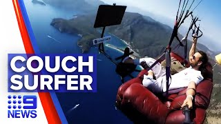 Paraglider launches into air on couch | 9 News Australia