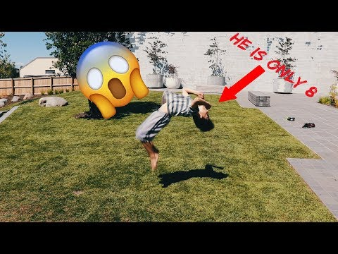 8 year old does a backflip flat