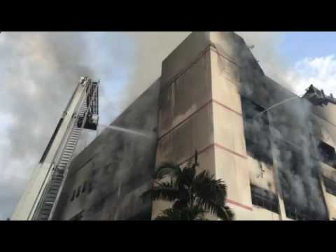 SCDF personnel at work at the C K Building fire