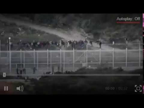 Infiltration Party Storming Border Fence At Spanish Enclave