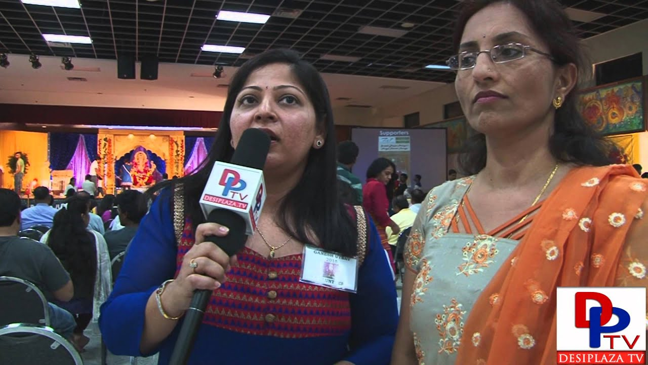 Volunteers from Siddhi Vinayak Ganpati Mandal speaking to Desiplaza TV