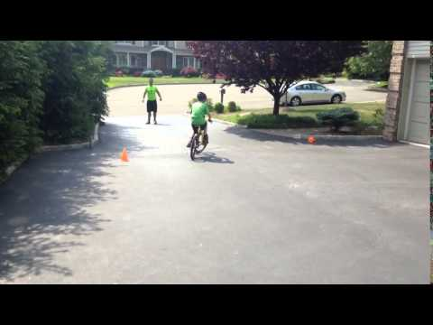 Eli Behar of Woodcliff Lake learns to ride a bike with encouragement from Sample Fitness.