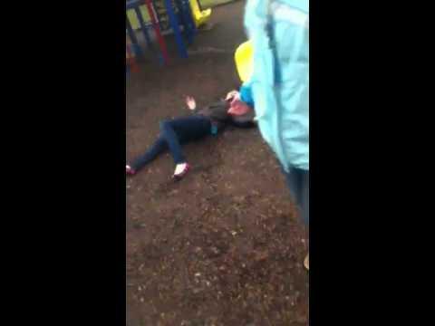 Kristen falling down slide at aberdeen