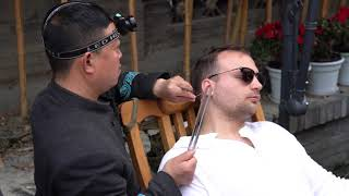 Chinese street ear picking. Ear cleaning for a man China ASMR