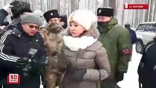 Казаки с шевронами Новороссии срывают ледовые гонки