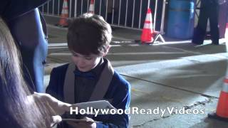 Max Charles greets fans arriving at the Mr. Peabody & Sherman premiere in Westwood