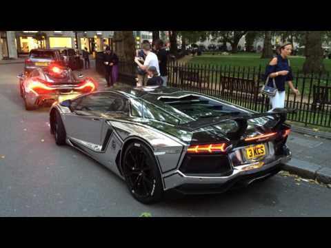 Chrome McLaren P1 and Aventador in London pulling away
