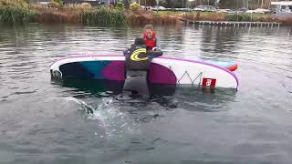 Rescuing another paddler on paddleboards