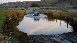 VW Thing crossing the Mojave River in Afton Canyon