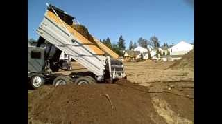 Dump Truck Pouring Out Dirt At Construction Site - Lynnwood, WA