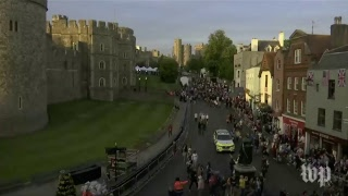 Crowds line the streets outside Windsor castle ahead of royal wedding