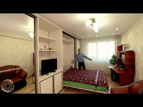 Шкаф-кровать трансформер в исполнении с подъемной кроватью для гостиной и спальни в одной комнате