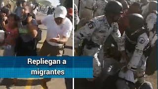 Guardia Nacional frena a golpes a migrantes en Chiapas