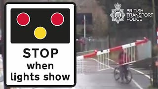 Caught on camera: cyclist traps himself between level crossing barriers at Cambridge