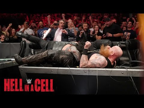 Roman Reigns Spears Erick Rowan through the announce table: WWE Hell in a Cell 2019