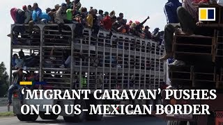 'Migrant caravan' pushes on to US-Mexico border
