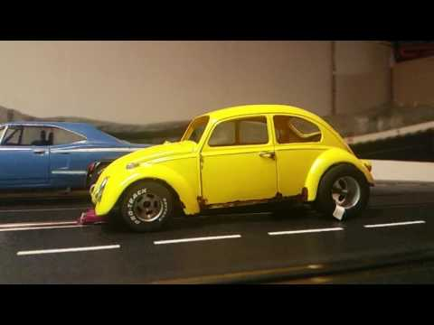 Slow motion slot car drag racing