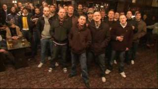 Football hooligans singing song