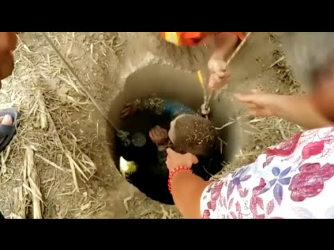 Boy Falling in Well Saved by Firefighter in Central China