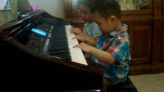 andrew cd was playing piano at a daddy 's friend's house....really excited