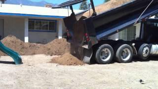 Dump Truck dumping dirt.
