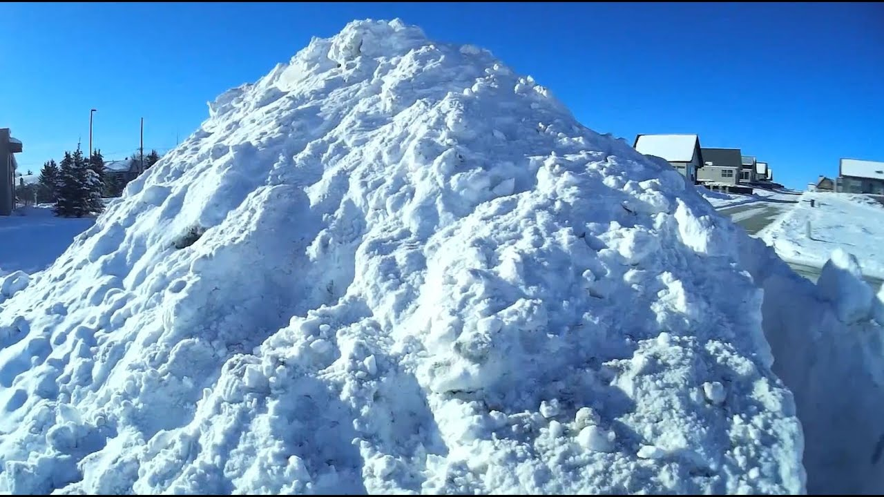 building a giant igloo ice cave in snow pile youtube