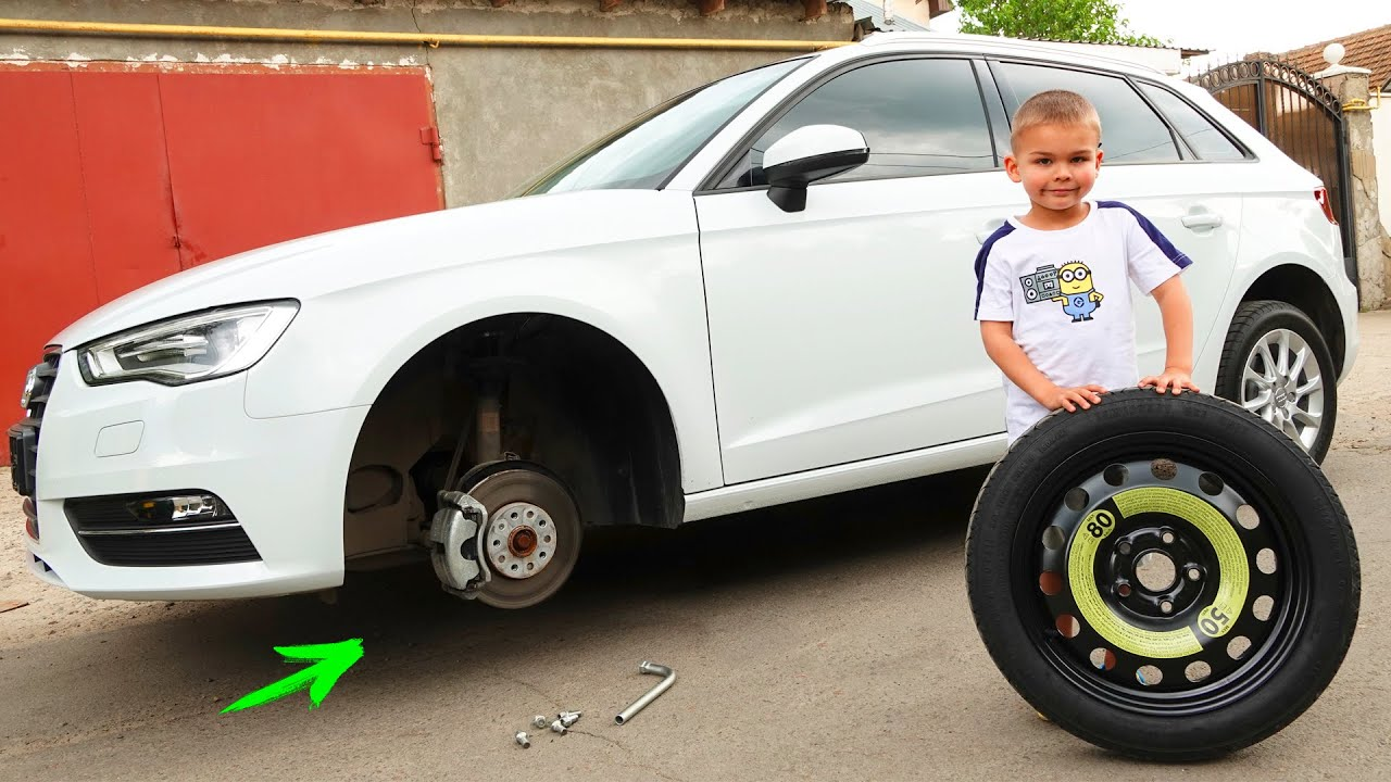 The wheel went down on AUDI A3 - Dima on tractor helping man