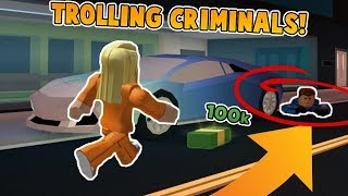 TROLLING CRIMINALS WITH MONEY IN JAILBREAK!! *TROLLED* (Roblox Jailbreak)