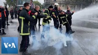 Police Fire Water Cannon at Protesting Firefighters in France