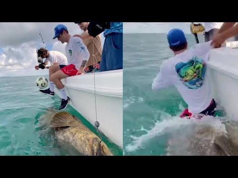 Chelsea player Christian Pulisic  fall off boat onto large fish while juggling ball as Sancho trolls