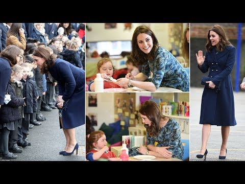 Kate shows off her blossoming bump in navy coat for first engagement of 2018